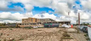 Im Moment wird nur abgerissen, aber ab 2021 entstehen13 neue Gebäude auf dem Gelände der früheren Zigarettenfabrik.